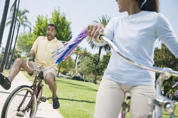 Multi-ethnic couple riding bicycles