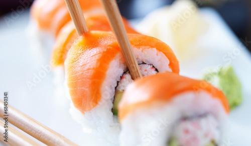 eating sushi with chopstricks panorama photo - 68450341