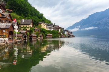 Hallstatt village in Alps at misty day, Austria
