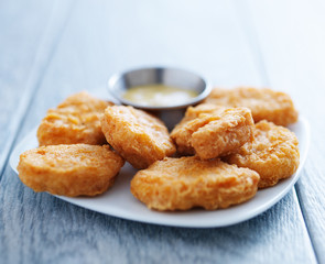 chicken nuggets with honey mustard in natural light