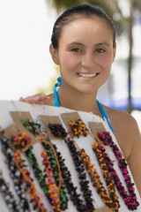 Hispanic woman selling necklaces