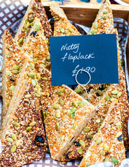 Flapjack British slices with pumpkin seeds in the market