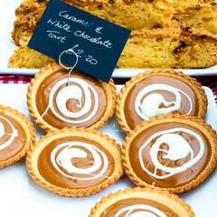 Caramel and white chocolate British tarts in the market