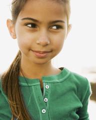 Hispanic girl looking sideways