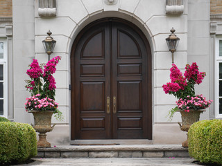 wooden double doors with flower pots