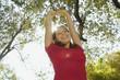 Hispanic woman with arms raised