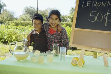 Hispanic siblings selling lemonade