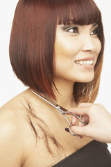 Pacific Islander woman having haircut