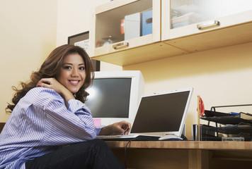Hispanic woman in home office
