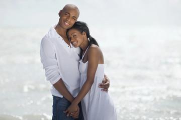 Multi-ethnic couple hugging at beach