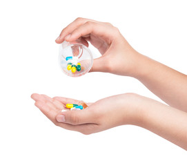 Druge capsules and pills in hand