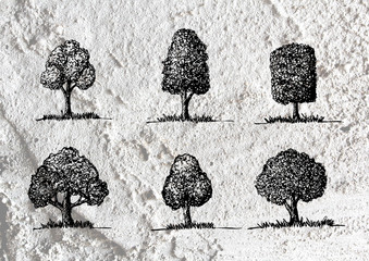 trees with leaves  in silhouettes  on wall texture background de