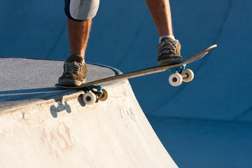 Skateboarder riding in the bowl