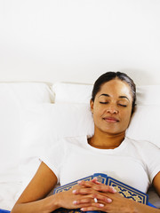 African woman sleeping with book