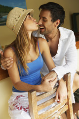 Couple kissing in bar
