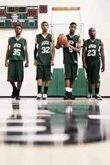 Serious African basketball players in gym