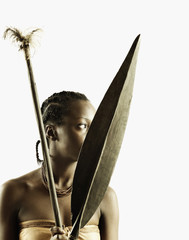 Young tribal woman holding weapons