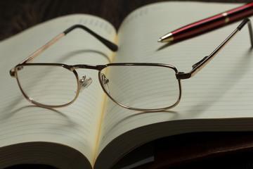 Notepad and glasses