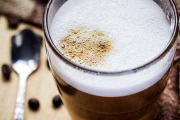glass of cappuccino coffee on wooden