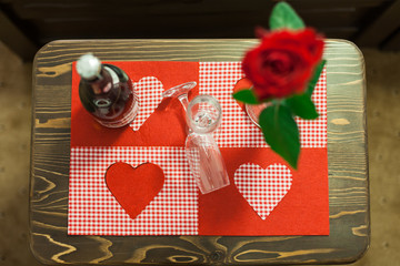 Nice red rose decorated table with two glass and champagne