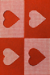 checkered background in red tones decorated with heart