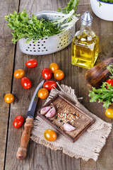 Salad ingredients on a rustic wooden background