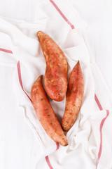 Sweet potato over white wooden background
