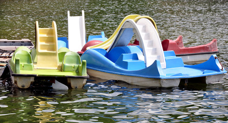 modern pedal boats on the water