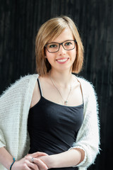 Girl with glasses smiling at camera