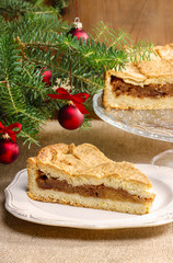 Apple pie in christmas setting. Cake on wooden table,