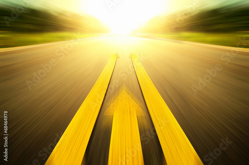 Yellow arrow Line exceeding on the road. - 68464978