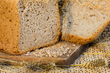 Homemade bread on a rustic scene with wheat