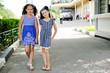 Portrait of two pretty school age girl friends