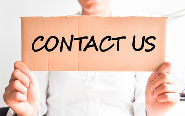Contact us message on cardboard