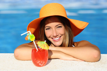 Beauty woman with perfect smile in a swimming pool on vacations