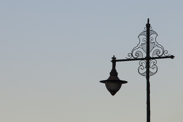 Marrakesh, Morocco: Street lamp and exterior mosque wall with mi