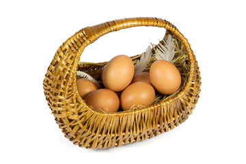 Brown Chicken Eggs and Pen in a Wicker Basket Isolated on White
