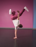 Cool break dancer doing handstand on one hand