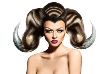 Beauty sexy woman with horns on hair and ring in nose