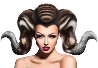 Fashion creative portrait of beautiful woman with horns in hair