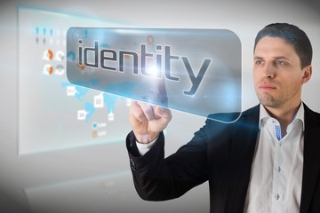 Businessman pointing to word identity