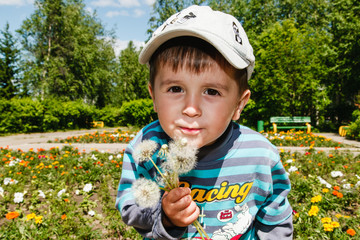 kid with dandelions