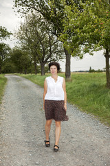 Woman taking a walk on the dirt road