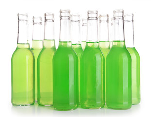 Bottles of drink on light background