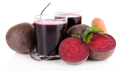 Glasses of fresh beet juice and vegetables isolated on white