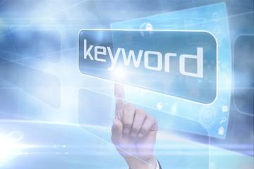 Businessman pointing to word keyword