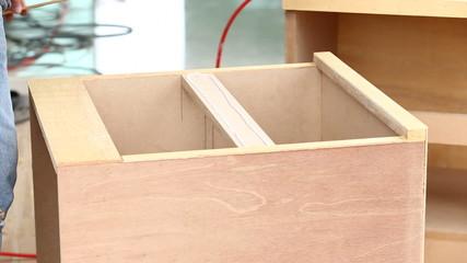 carpenter used air-gun for make new furniture