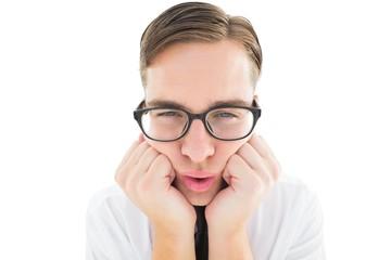 Geeky hipster falling asleep on hands