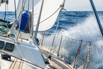 Fast sailing cruising yacht at heeling