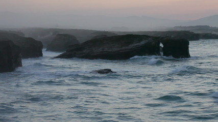 Storming waves during inflow at sunset on Playa de las Catedrale